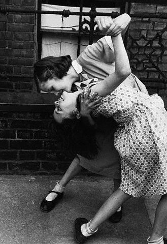 Two girls dancing in the street, 1940s