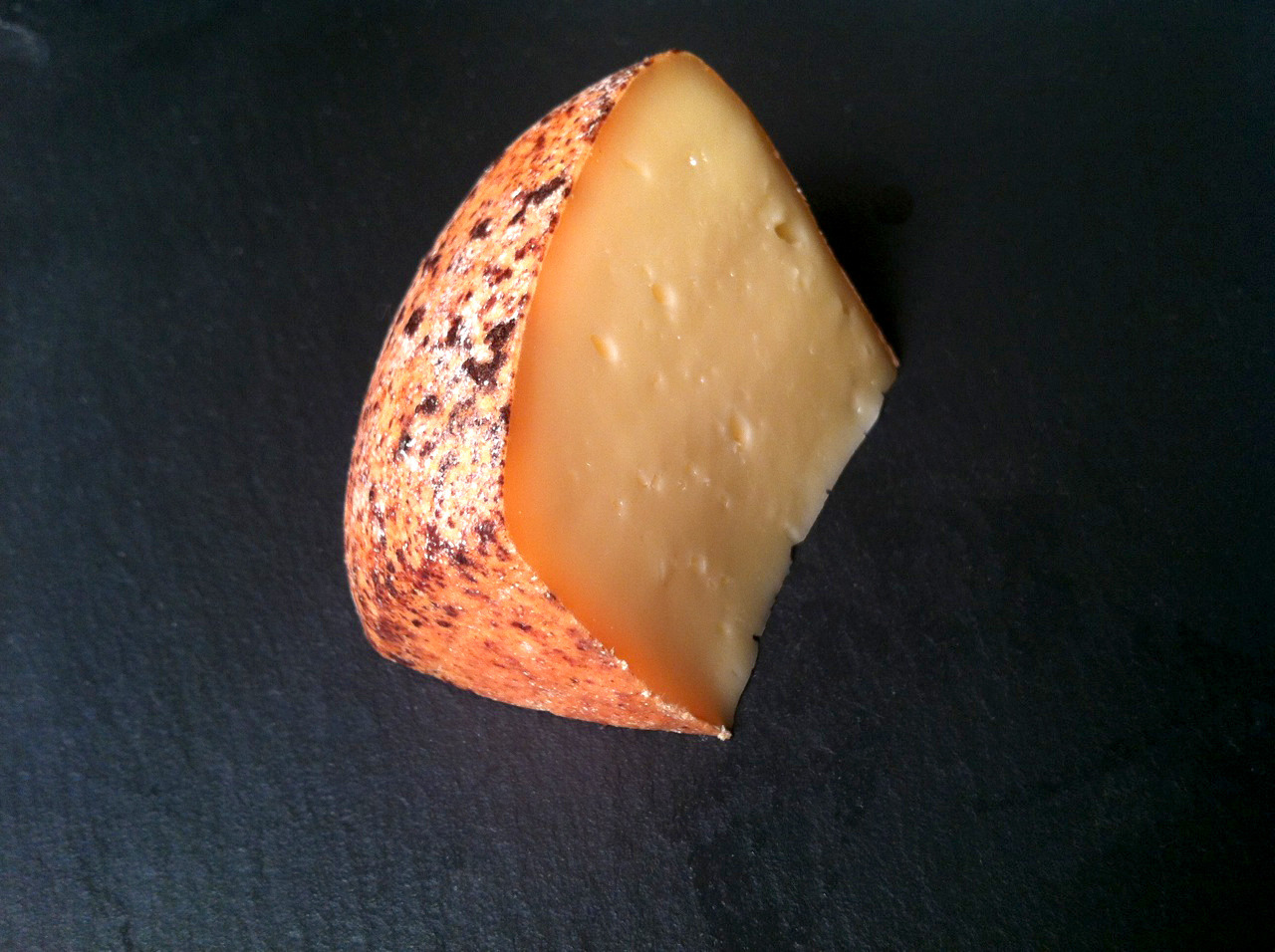 Another Rolf Beeler-affinaged cheese: Aarauer Bierdeckel, also known as Beermat, a washed-rind raw cow's milk cheese from Canton Aargau in Switzerland. Washed in unfermented wheat beer, it brings the elements of a traditional French washed rind together with the flavors and character of a trappist beer-washed cheese.  The amber-pink B.Linens rind, spotted with dark reddish-brown patches, is thin and lightly sticky covering a yellow paste, lightly eyed, firm at first and sagging softly as the cheese warms. A musty, yeasty aroma gives way to a pleasantly yeasty-sour, nutty, rich flavor with toasted undertones and a lingering finish.  Wonderful paired with beer (naturally).