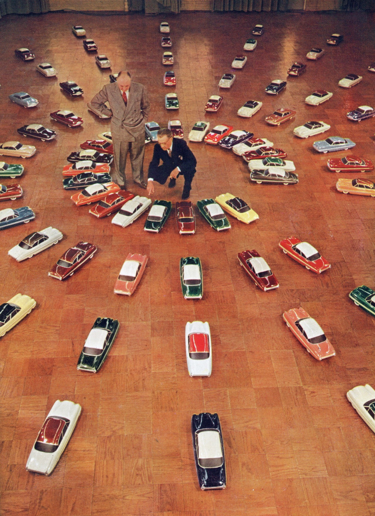 Ford executives selecting the 1953 automobile colors from 76 different scale models.