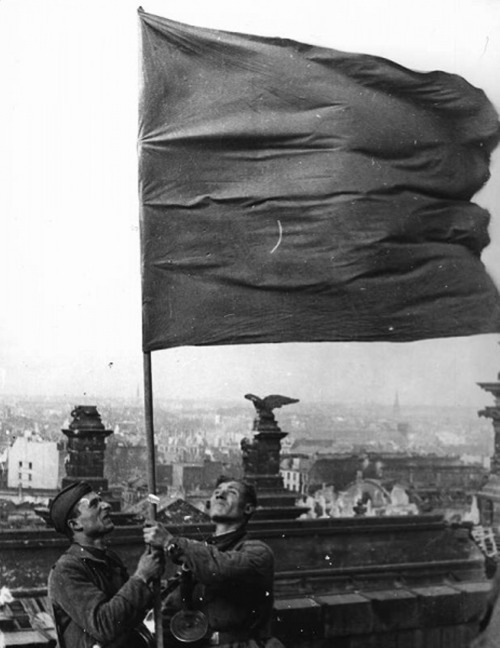 Soviet troops raise the flag over the Reichstag, May 2, 1945. Anatoly Morozov