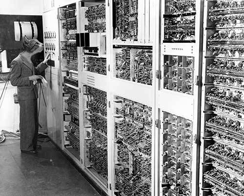 Dr 'Fluffy' Pearcey programming CSIRAC (Australia's first Computer) to dispense cat fud.