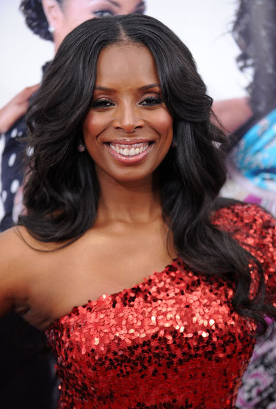 the sassy tasha smith has an oval face. as well as beyonce but she's all over the damn place. and i like tasha :) she used to rock a banging ass bob that out did rihannas good girl gone bad days.