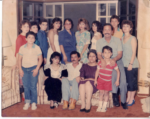 This is a picture of my grandparents and their 13 children (my aunts and uncles and my mom) I bet you can't guess which one is my mom.