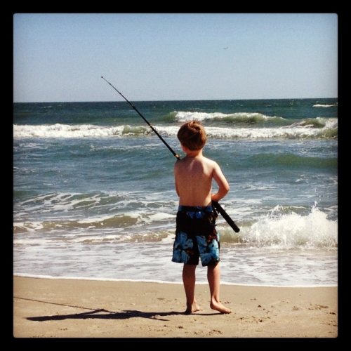 Becket fishing at Fort Macon (ours)