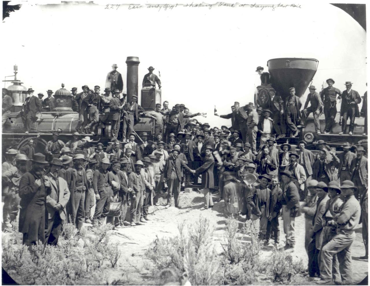 "Image description: This photo shows the joining of two railroads, marking the 143rd anniversary of the completion of the First Transcontinental Railroad across the United States. Completed on May 10, 1869, the railroad shortened the cross country trip from four months to just one week. A ceremony was held in Promontory Summit, Utah, about 35 miles away from where the railroad was joined together by the ""Golden Spike,"" which finally connected the two sides of the railroad, marking its completion. The National Park Service now operates the Golden Spike Historical Site in Promontory Point, Utah. Learn more about the First Transcontinental Railroad. Photo by A.J. Russell and Charles Phelps Cushing, photographers documenting the event."