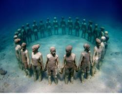 belleandwhistle:  breyanarae:   elegantlytasteless:  Underwater sculpture, in Grenada, in honor of our African ancestors thrown overboard.   I couldnt not reblog this, it's so powerful to me.  oh my god.  Oh goodness..