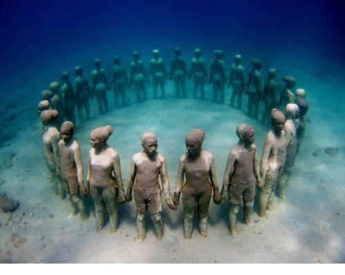 Underwater sculpture, in Grenada, in honor of our African ancestors thrown overboard.    I couldnt not reblog this, it's so powerful to me.