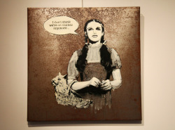 "BANKSY ""The Streets of the World"" Converge at Opera Gallery Tonight""Watching the transition from ignominy to untouchable over a little more than a decade is positively head spinning as the identities of many of these same artists were once shrouded, and some still are. When you look at pieces made specifically for the gallery, it can be gratifying and illuminating to see whose talent can evolve and deepen when there is no need to hit and run, or look over your shoulder.""Banksy (photo © Jaime Rojo)"