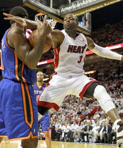 siphotos:  Dwyane Wade drapes himself all over Amar'e Stoudemire during Thursday's Heat-Knicks game. Miami, which held a 3-1 series lead, defeated New York 106-94 and ended the Knicks' season. (Marc Serota/Getty Images) DOLLINGER: Knicks left with questions after disappointing playoffs