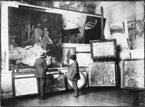 artistandstudio:  Monet in his studio with the Duke of Treviso looking at the central part of the Luncheon on the Grass in 1920.  via