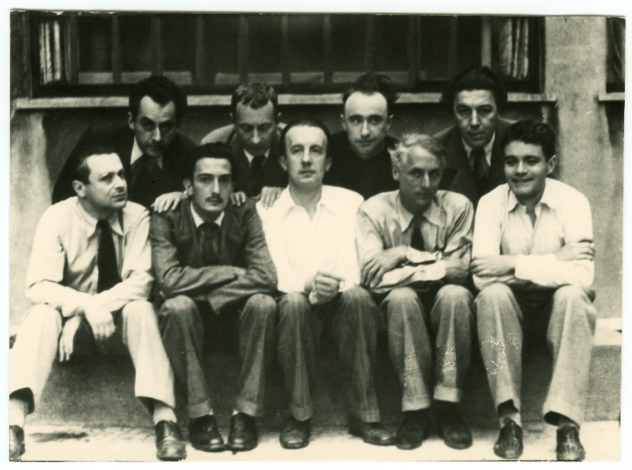 Surrealist Group, 1930 from left to right (top): Man Ray, Hans Arp, Yves Tanguy, Andre Breton. from left to right (bottom): Tristan Tzara, Salvador Dali, Paul Eluard, Max Ernst, Rene Crevel  Swear I'm related to Man Ray. He looks like just about every dude on my dads side.