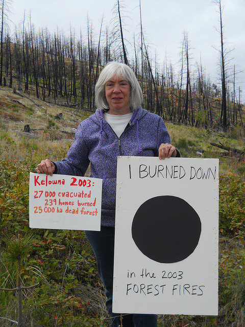 Climate Dot in Kelowna, BC on Flickr.350 members travel to the site of their old house- which burned down in the 2003 wild fires. #fire