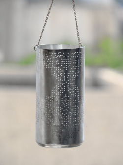 Soda Can Lantern Soda can pierced with patterns derived from Traditional Palestinian Embroidery