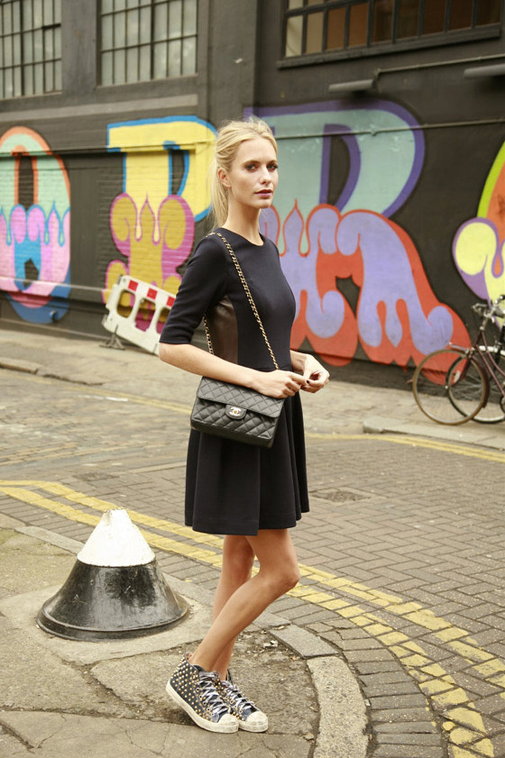 positivelynoteworthy:  Poppy Delevigne pairs her little black dress with a classic Chanel bag and a pair of studded sneakers. (via thismodernlifestyle, stylemint)