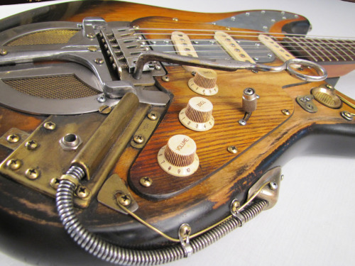 "http://youtu.be/9OghBfVvHLk Yes Tony Cochran Guitars are awesomely playable! Here's the Pepperjackcaster with the hammer down in France. Pried from the cold, gray fingers of Jack ""Wild Cat"" Thompson. He was found dead and naked at the seedy motel just North of Bakersfield, California in 1958. Master of the dirty Honkey Tonk, he spent his life chasing cheap women and drinking cheaper wine. Rumor has it, the device at the bottom was what he called a ""Seductorator"". He said it loosened women's inhibitions: wouldn't say where he got it."