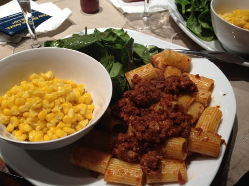 Pasta w/ meat sauce; corn and spinach on the side.