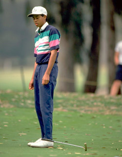 gearpatrol:  Tiger Woods, 15, drops his club in anger after missing a shot. Courtesy of the SI Vault.