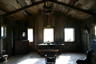 Horse Barn Loft. The bareness, the vintage wood furniture pieces, the metalwork objects and the natural light all make this space so interesting and curious. The wood looks like it has a rich story to tell.