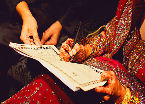 bride singing nikah papers