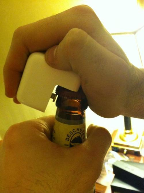 laughingsquid:  Using an Apple Power Adapter as a Bottle Opener