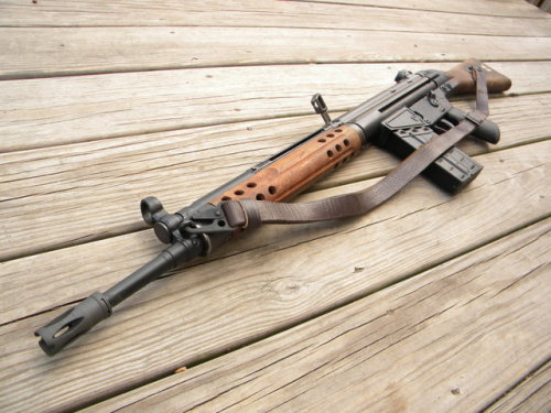 gunrunnerhell:  Classic G3… (Most main battle rifles have had a mix of wood and polymer furniture. The FAL, the M14 and the G3 are the most recognizable main battle rifles out there. I like these rifles with wood but hate that they can get damaged or chipped easily; especially when you put in a lot of time refinishing it.)   I have such a hard time telling the difference between the G3 and the CETME, I know the CETME came first and that they were designed by the same guy(Ludwig Vorgrimler). But other than that I can't tell what the difference is.