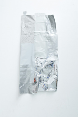 Kelly Jazvac, Untitled, 66 cm x 132 cm x 1 cm, salvaged adhesive vinyl, 2008