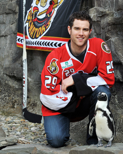 Mike McKenna and a penguin