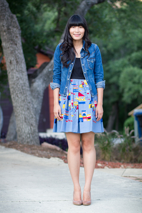 "2012. carnival life. denim jacket by billy blues (thrifted). anna sui dress. steve madden selena wedges.i bought this dress in my ""pre-blog"" years, and i never sported it until today (seriously). i've been going through my closet and donating or selling items, but i couldn't part with the amazing circus print. when forced to use it or lose it, i chose to keep it and give it sartorial love. the dress received compliments from teachers and kiddos, many of whom thought i made it. i wish!presently i'm sitting with M in our office, listening to the rain with a little dog under my feet. thunderstorms aren't so bad with my two musketeers.the look 