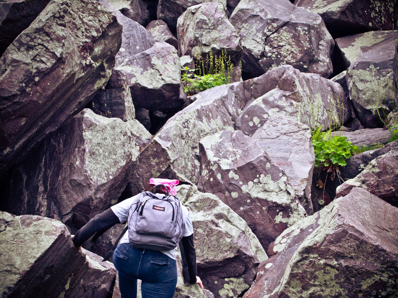 Tina climbing big rocks at Devil's Lake.