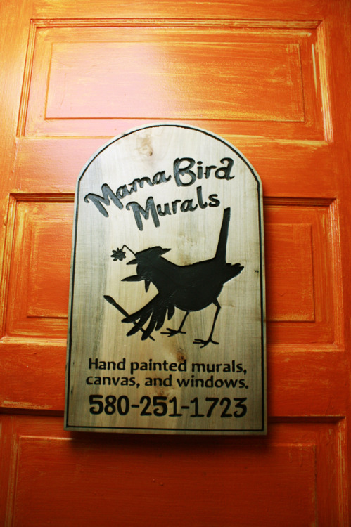 A carved maple sign for Mama Bird Murals