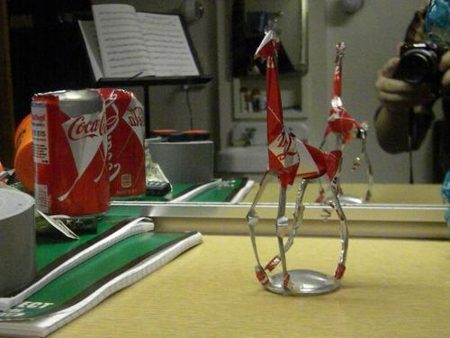 A GIRAFFE MADE OUT OF A COCA_COLA CAN! That's a giraffe. I made it and I really like it. I forget who has it now, but it was back before my 'art' was 'appreciated'. I'm done with my finals and I am SO HAPPY. I'll be packing tonight, but the giveaway is still in place. Giveaway? This give away! (Hermoine used Copy/pastendio)  I'll be making a PKCN for free for whoever has the most casual linked mention of me in their blog. Yes that's the actual feat. 'Hey, I found this cool blog…check it out er whatever'. But you can say whatever you want. I'll make it as soon as I get home, the winner will be announced with a special post (the flavor image will have confetti on it), and their district will get free food for a year. Man, I've gotten rusty at posting. Is there a tumblr gym where I can work out?Holy crap there is! Anyway, you have to reply to this post with the link to your very casual post, you have to reblog this post, and you have to wear a silly hat. Although I can't judge that. I think I'll be able to tell. Anyway, have fun, and may the curve be ever in your favor. I definitely see some front runners already, but keep 'em, coming. I'm really enjoying them. By the way,  I'll be doing one for 'sneaky' in the future, but the goal now is CASUAL. So, be safe and know that I care. I do care. Ask me a question if you want.
