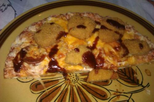 my roommate made a peperoni pizza with chicken nuggets and bbq sauce on it, ate half of it, and left it on my bed as he went to work right now. ok
