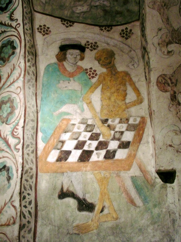Death playing chess.