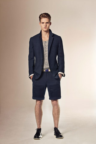 "Spring 2012 Elie Tahari. Usually I am a pants type of guy, but with summer in LA quickly on the rise, I know comfort also becomes a big motivator. So I have been known to deviate from time to time, and for good reason! This is a very simple, chic, summer look, with light material you're sure to be thankful for. That way, when you're standing in the fiery heat of the sun, you won't be left thinking ""milk was a bad choice"".  Simple way to make this look Navy blazer Grey tee Khaki belt Navy shorts Tremont boot"