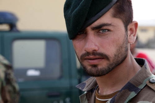 afternoonsnoozebutton:  landofthelions:  An Afghan National Army soldier looks at the camera during vehicle search training instructed by U.S. Soldiers at Combat Outpost Jaghato, Wardak province.    Mon dieu.