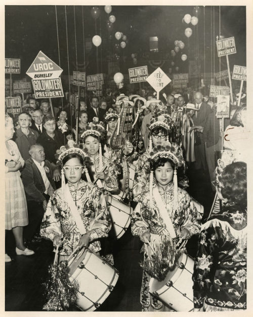 coolchicksfromhistory:  Female Chinese band parading through a crowd at a political event supporting the presidential campaign of Republican candidate Barry Goldwater. 1964