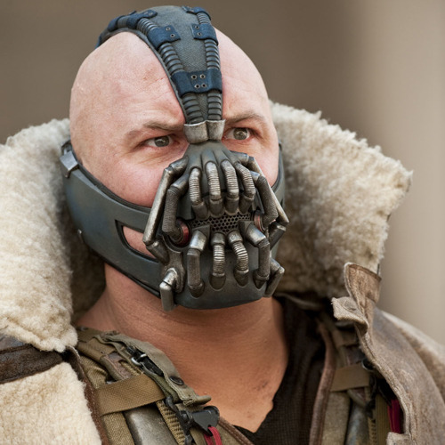 totalfilm:  World exclusive image of Tom Hardy as Bane in The Dark Knight Rises The Dark Knight Rises is, hands down, the most anticipated film of the year. So it's fitting that the film's incendiary anarchist should help kick off our very own revolution…