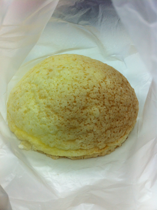 Melon pan - melon bread $1.30 Pullman Bakery 9 Raffles Boulevard #01-97/98 Milenia Walk Singapore T: 6337 3575  I love melon pan for its crispy top and soft bread inside, and this was fabulous! Although usual melon pan has a checkered pattern on top, the lack of that here was made up with its subtle melon flavour (normal melon pan has no melon flavour, its name derived from the top of the bread looking like a melon's skin). Yummy afternoon snack!