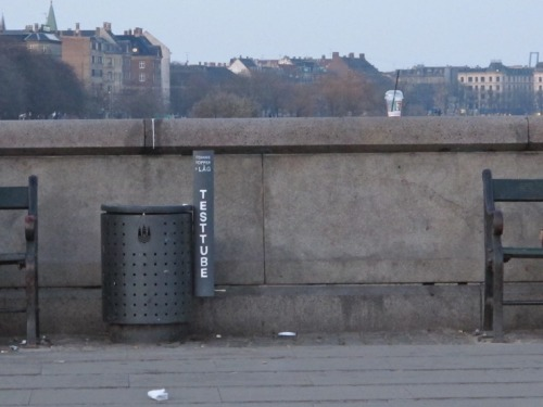 "Public Trash Cans That Aren't Overflowing with Empty Coffee Cups - Design - The Atlantic Cities: Copenhagen designer So Hoj noticed, and was bothered by, piles of spent coffee cups spilling out of trash cans and onto the sidewalk around the city.   Hoj, a self-employed designer with a background in accessories, took up the problem herself by converting tall, slender cardboard tubes from the post office into receptacles for discarded cups. The idea is simple enough: you can hold more cups in a smaller space when they're stacked neatly inside each other. Hoj's theory was that this would alleviate the cup problem by giving them their own, more compact space, and leaving larger trash cans for other items. … She mounted her ""test tube"" cup collectors and put them on two trash cans along the waterfront. Quickly, her fellow Copenhageners caught on.  Here's what the trash cans used to look like before her solution:"