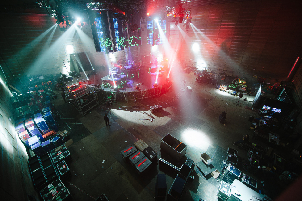 FROM THE ARCHIVE: Muse, Resistance Tour rehearsal, Elstree, 2009 by Danny (photo © Danny North 2009) Being asked to spend a day with Muse in the room where they built the Deathstar sounded like a dream job. I spent the whole day documenting the crew putting together the live show, the mechanics of it all. And then late afternoon, Muse turned up and ran through five or six songs. I just sat there in awe of my own private Muse show. For a second I thought I spotted the ghost of Obi Wan, but it was just a spotlight on a guitar tech. To get this shot I climbed up to a viewing platform.  There was only one way to shoot this and that was WIDE, one of the few times the Nikon super wide got some use. I think they were running through United States Of Eurasia at this point. POSTED BY DANNY