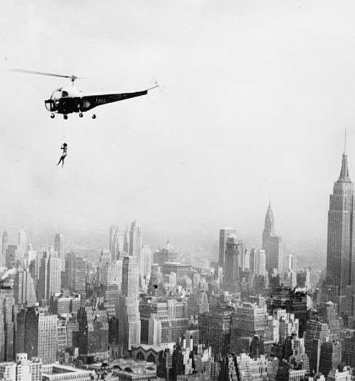 """Maryln Rich, suspended by a helicopter over the skyscrapers of Manhattan, performs stunts on behalf of the American Relief for Korea organization"" (1951, via)"