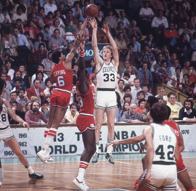 Celtics forward Larry Bird shoots over the outstretched hand of Julius Erving and Darryl Dawkins during a 1980 playoff game between the Celtics and 76ers. Philadelphia and Boston fans will see another chapter of this long rivalry unfold when the two teams meet in the second round of the playoffs. Both Boston and Philadelphia won last night to advance to the second round. (Walter Iooss, Jr./SI)    GALLERY: Rare Photos of Larry Bird | Julius ErvingTHOMSEN: 76ers celebration was nine years in the makingMANNIX: Vintage KG helps Celtics advance past Hawks