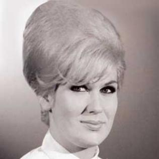 The beehive is one of those rare hairstyles that actually has an inventor. In 1960, a stylist named Margaret Vinci Heldt invented this piled-high style in response to a request from Modern Beauty Salon magazine to come up with something really different. Heldt turned to a velvet fez she owned for inspiration and came up with the backcombed, hair-spray heavy beehive style. It became a 1960s sensation, loved by women because it was easy to maintain in the days between weekly salon visits.