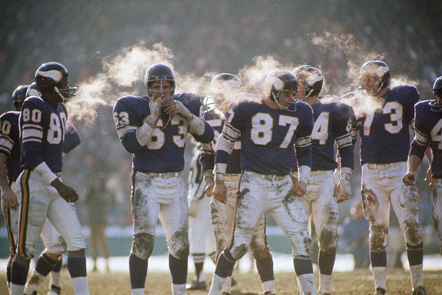 Members of the Minnesota Vikings offense — John Henderson (80), Jim Vellone (63), John Beasley (87), Gene Washington (84), and Ron Yary (73) — try and stay warm during the 1969 NFL Championship game against the Cleveland Browns. The Vikings would go onto win 27-7 to capture the NFL title before losing to the Chiefs in Super Bowl IV. This was the last Super Bowl before the NFL-AFL merger. (Neil Leifer/SI) SI VAULT: Vikings roll past Browns and advance to Super Bowl (1.26.70)