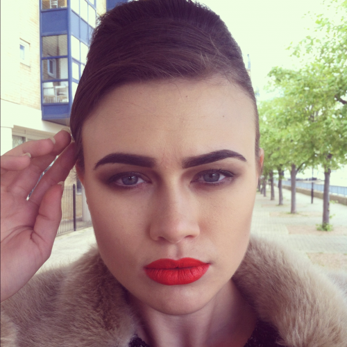 "showmemakeup:  Today's makeup look I created for the ""Fashion - Office Look"" I mixed Illamasqua & Avon together for the models base. And I mixed together two lipstick shades from Grimas to get this colour! On her eyes, I used browns to shape the eye socket and elongate the outer half of her eyes. I used white along the waterline to open the eyes up!"