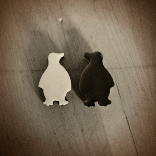 I made some chocolate penguins in an ice cube tray today. They are made of white and milk chocolate and have a peanut inside.