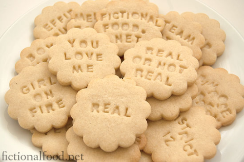 "Hunger Games cookies, made with Williams-Sonoma's Message in a Cookie Kit. I think I might need to get this kit—it's only 20 bucks. Think of all the geeky things you could write on cookies! ""Live Long & Prosper."" ""Force B w/u."" ""I Love You."" ""I Know."" ""Bowties R Cool."""