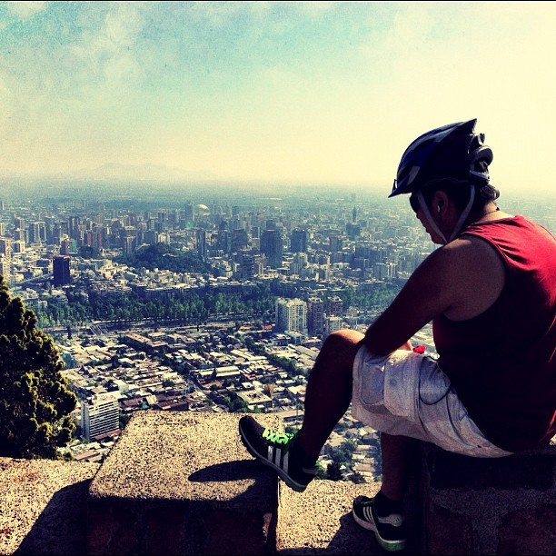 Tired Cyclist in Santiago #chile #santiago #sancristobal #cycling #bike #biking #southamerica #iphoneography w/ @davsp100  (Taken with Instagram at Virgen Cerro San Cristóbal)