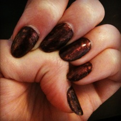"""Hidden Gold"" nails: Step #1 - Apply two coats of brown (or the dark colour of your choice) Step #2 - Apply a third coat to each nail in turn and, before it dries, sponge golden polish on it, so it will mix a little with the brown. Step #3 - Apply one or two layers of glaze. Ta da!"