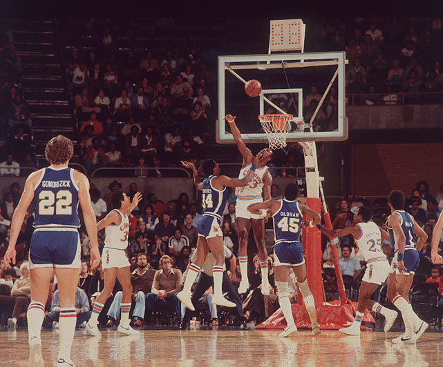 "Clippers forward Joe ""Jellybean"" Bryant blocks a shot during a 1980 game against the Lakers. Bryant may be best known as Kobe's father, but he played eight seasons in the NBA before moving overseas to play in Italy. In this week's Sports Illustrated, Chris Ballard profiles Kobe Bryant and the influence his father had on his life. (Richard Mackson/SI) BALLARD: Where does Kobe's greatness come from?GALLERY: Rare Photos of Kobe Bryant"